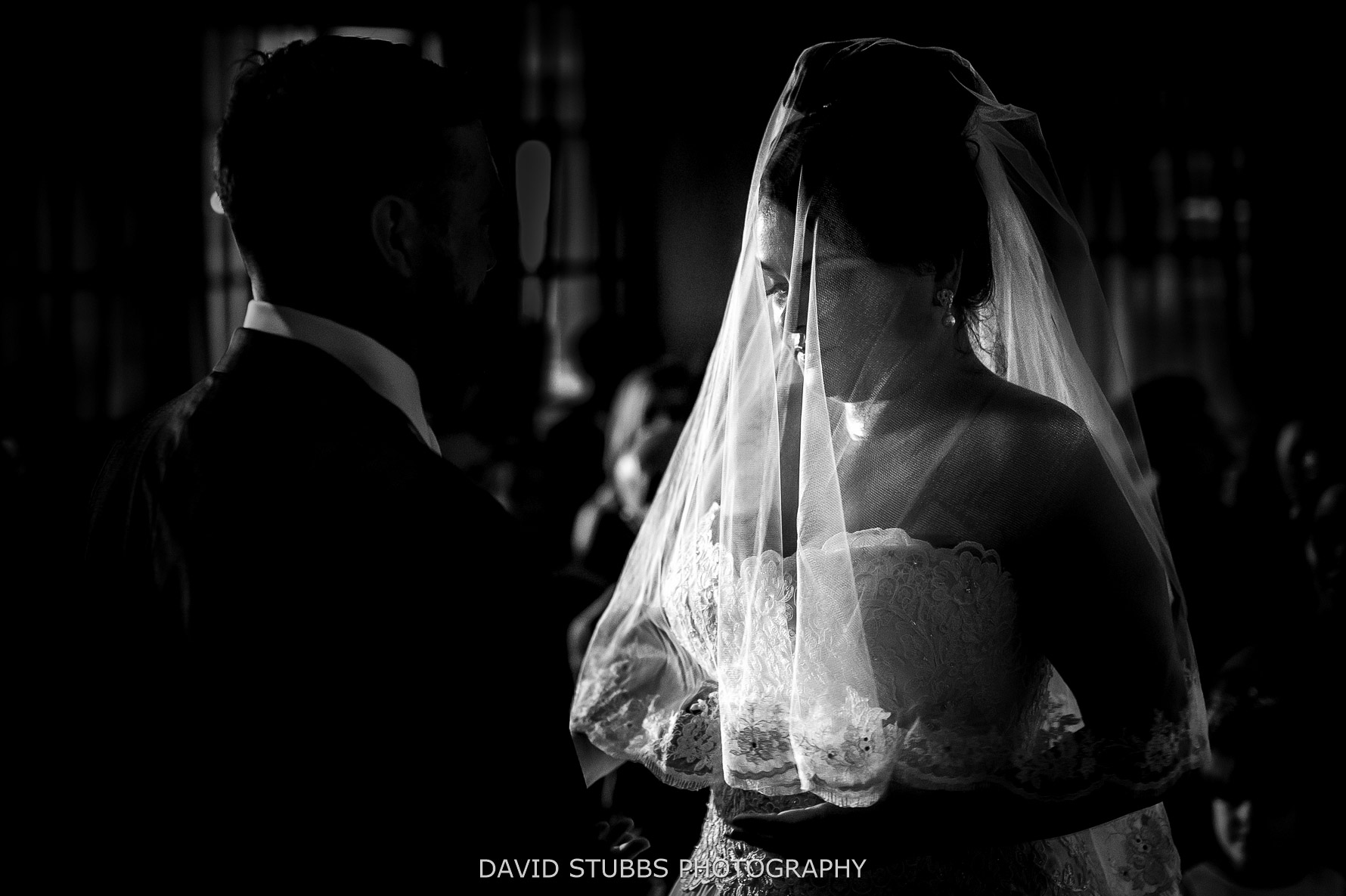 wedding ceremony in black and white with light from behind