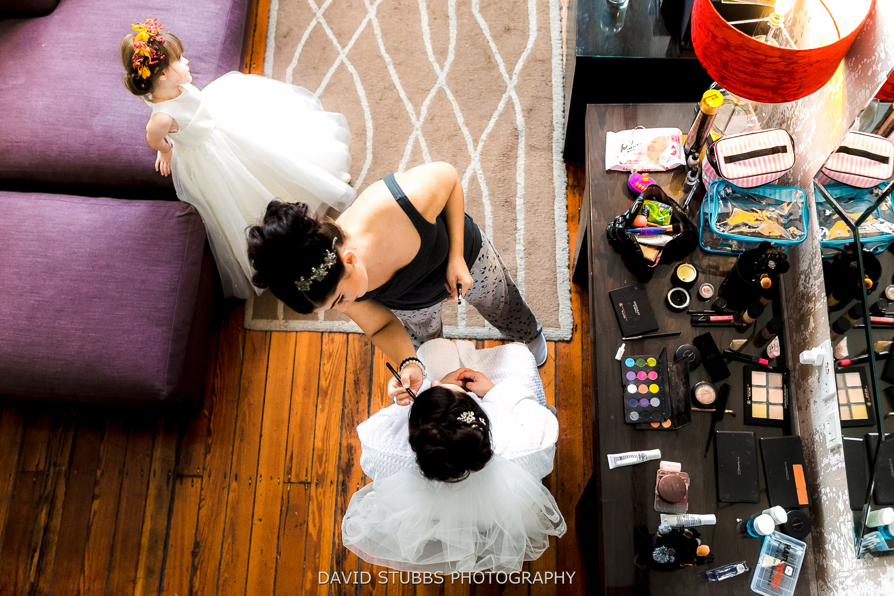 bridal preparations photographed from the balcony