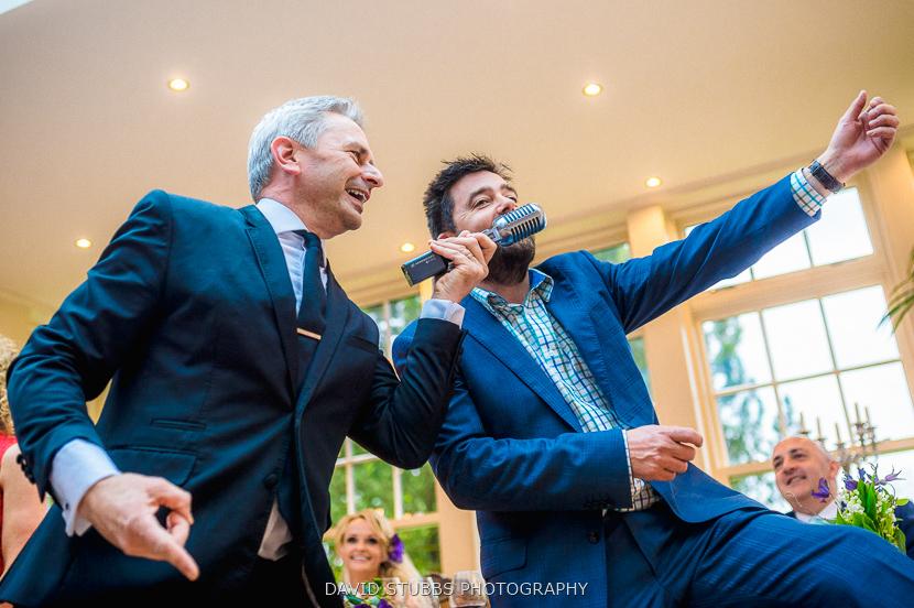 men singing at party