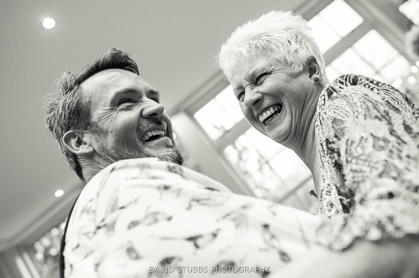 man and woman dancing laughing