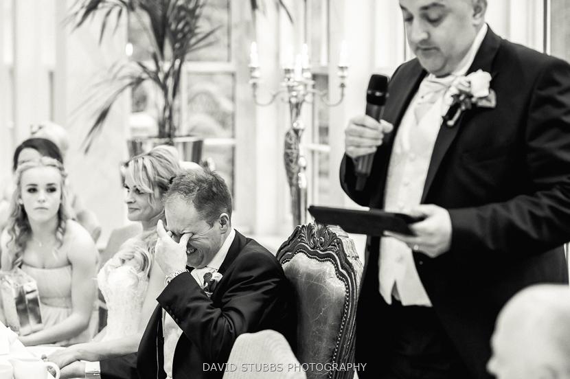groom cringing at best man