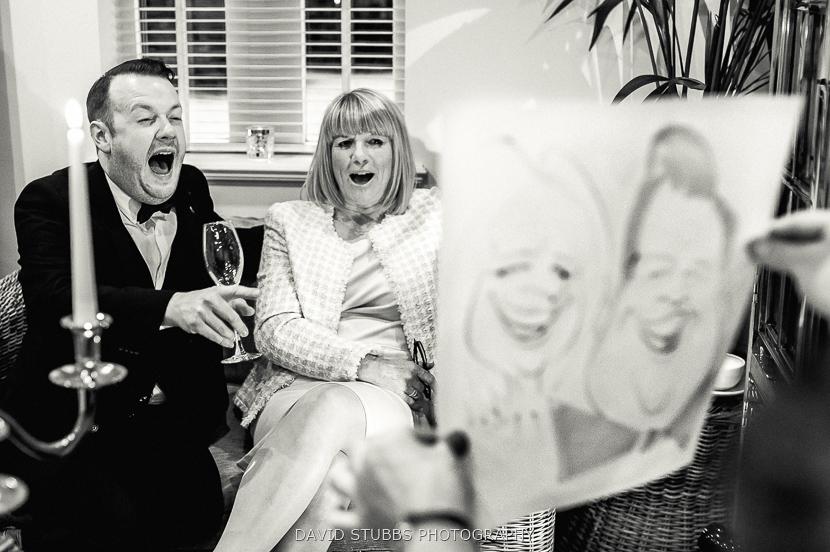 man and woman laughing at drawing