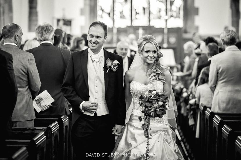 married couple walking down aisle