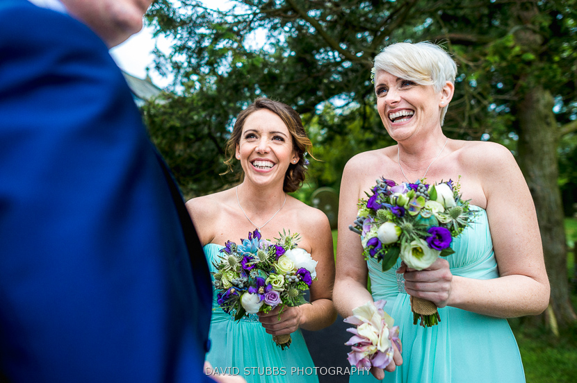 bridesmaids laughing outside