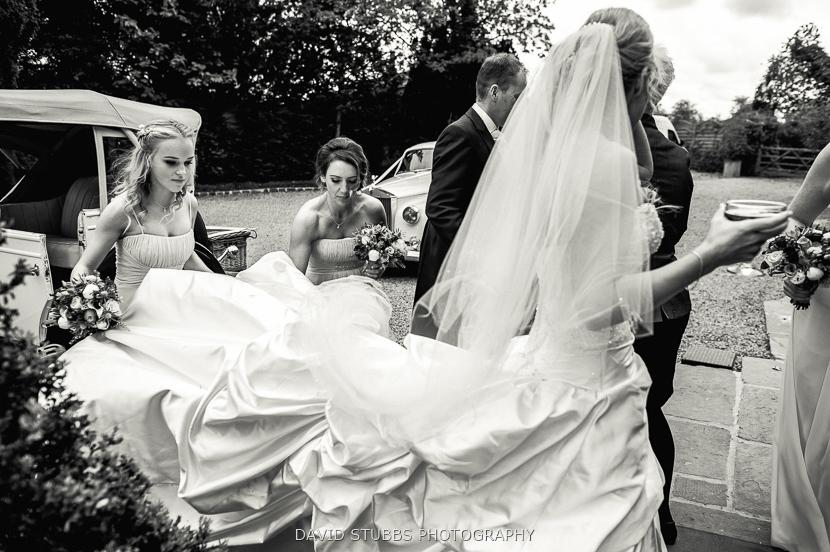 bridesmaids holding dress