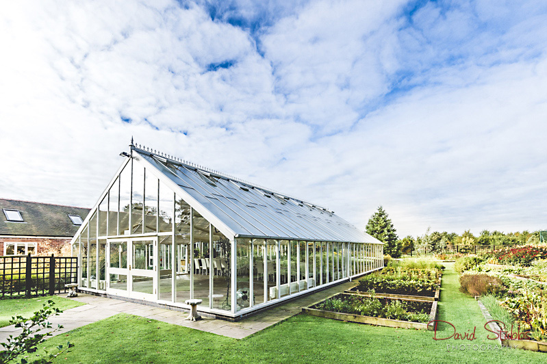 glass house in blue sky