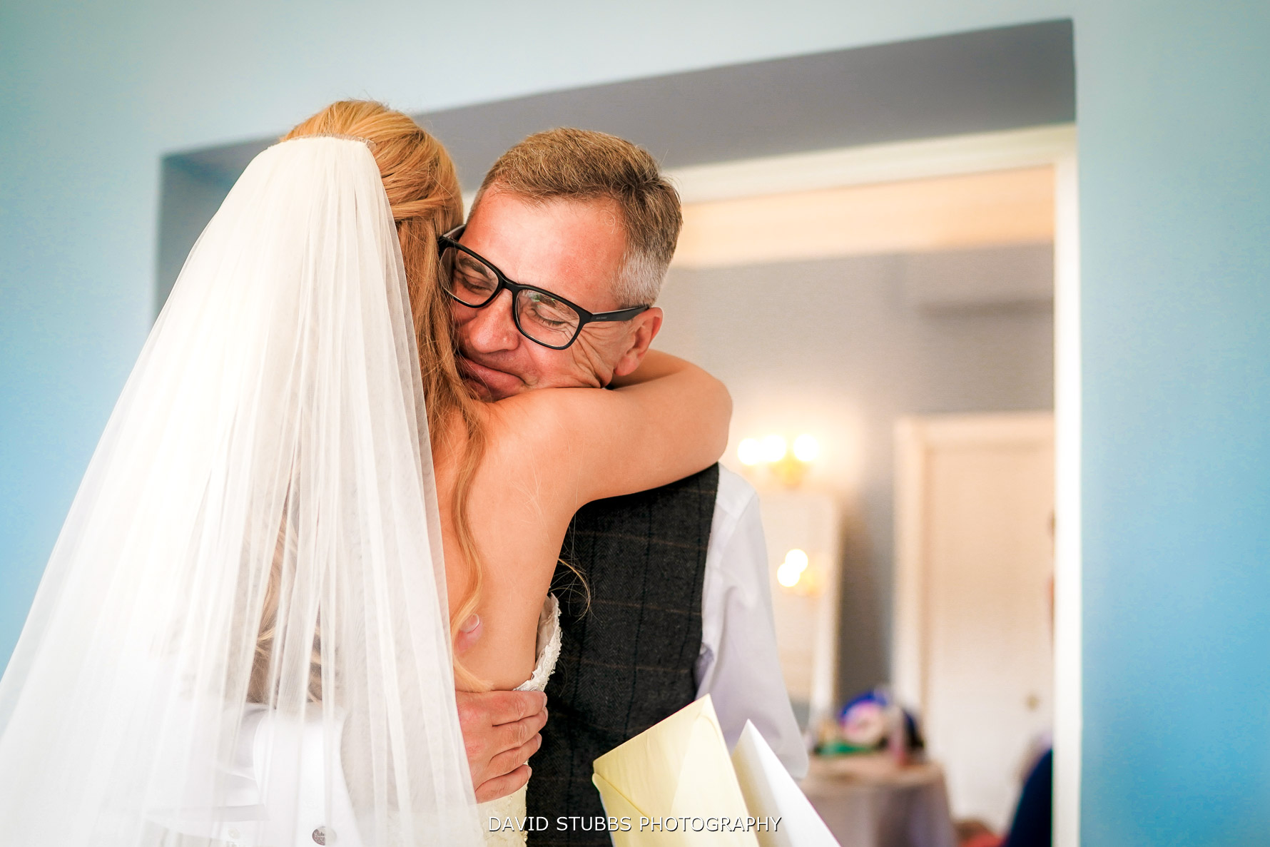 hugs from father of the bride