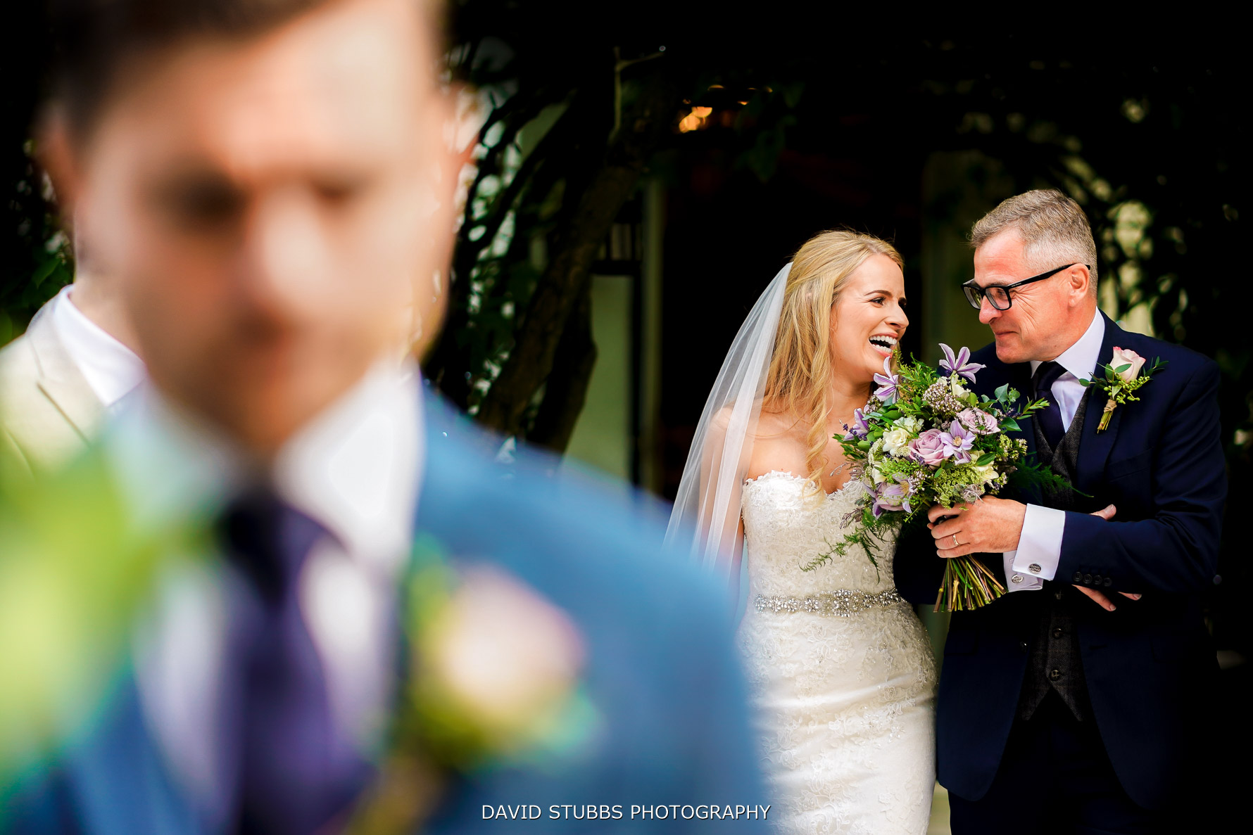 bride and dad together as they walk down the isle for the wedding