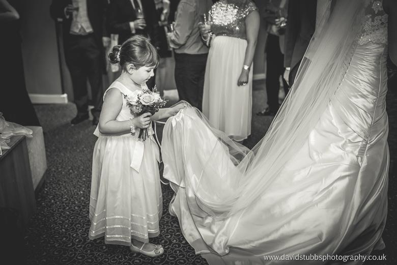 flwoer girl holding wedding dress