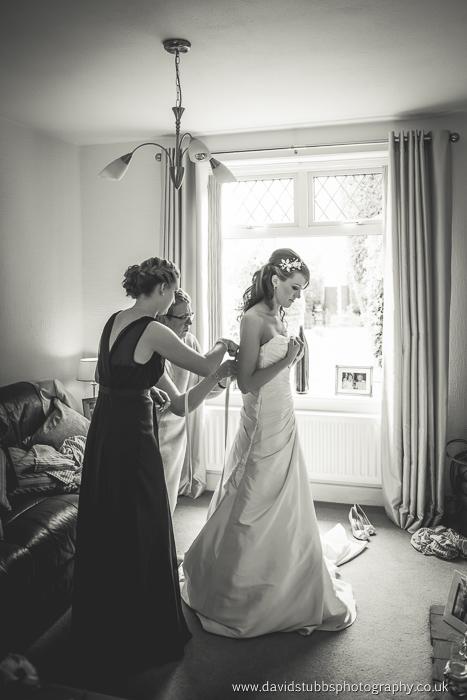 getting in her wedding dress