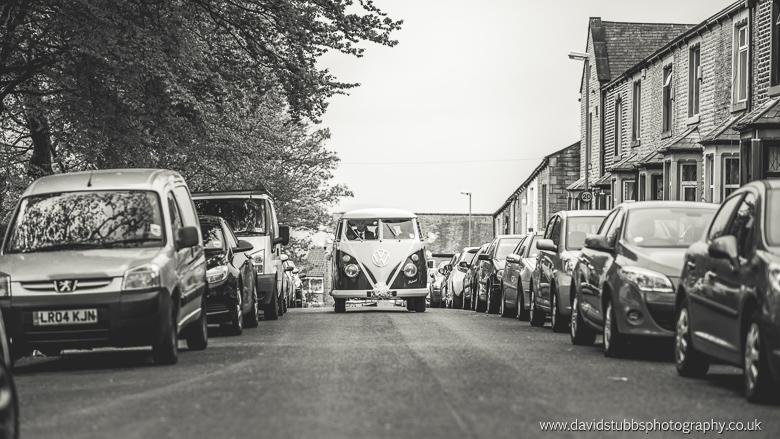 vw campervan arriving with bridesmaids