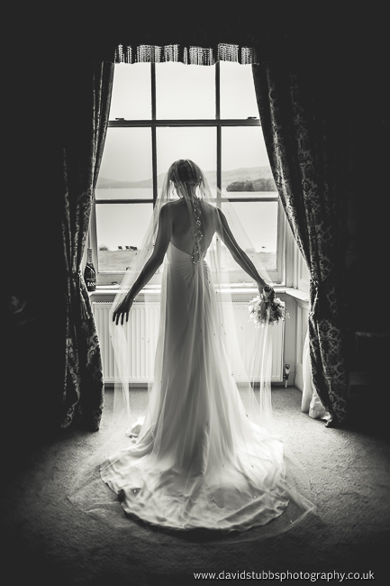 bride int he window at storrs hall looking over windermere