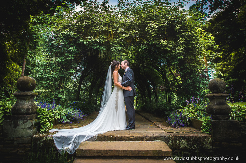 bride and groom in arch