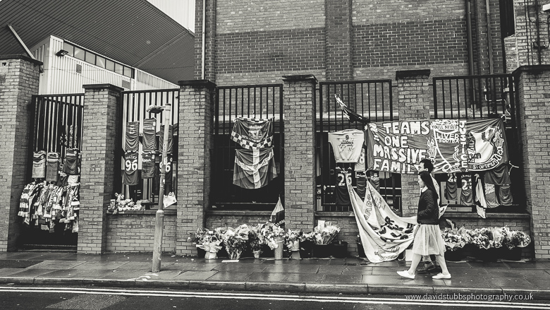 flags outside liverpool fc anfield