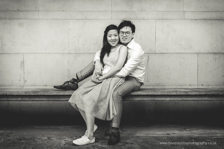 newly engaged couple on bench