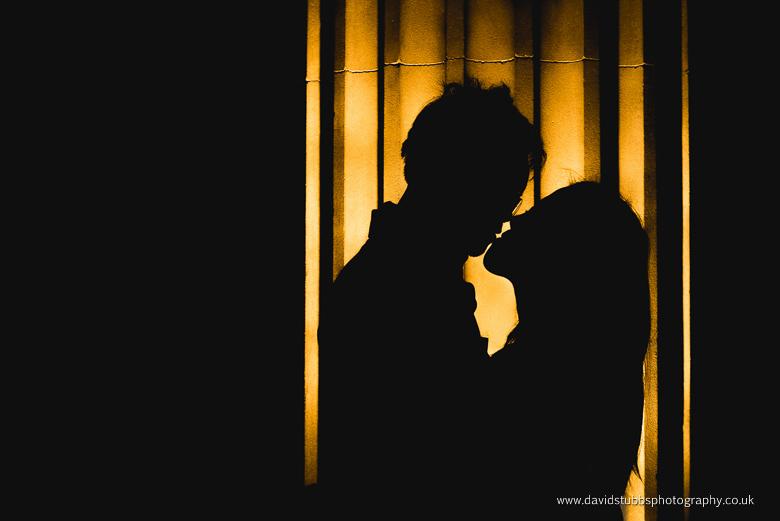 silhouette couple kiss orange