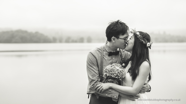 engagement black and white kiss by lake