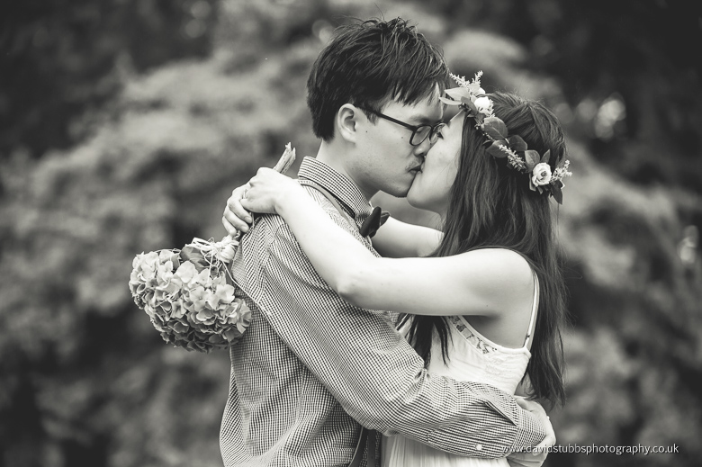 woman holding flowers and kissing fiance