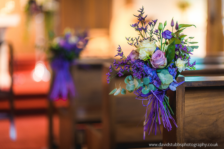 flowers on church pews