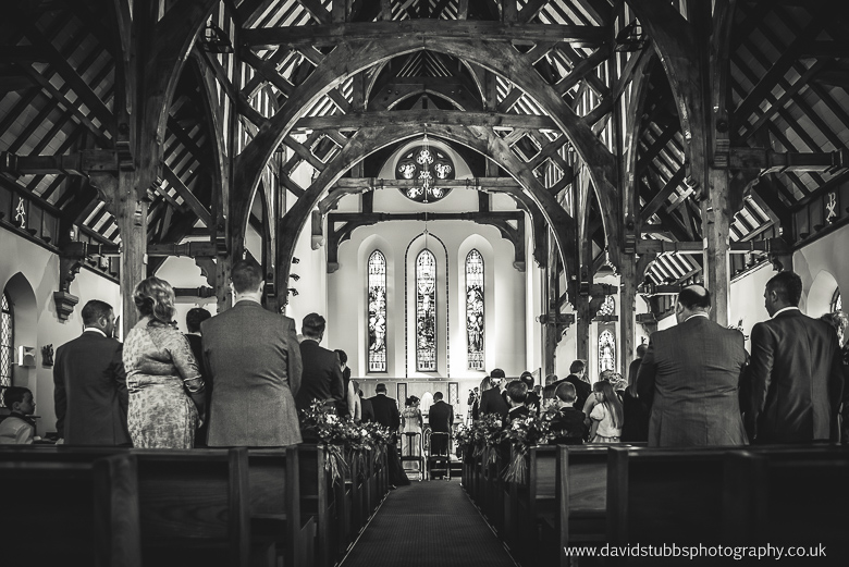 congregation standing up black and white
