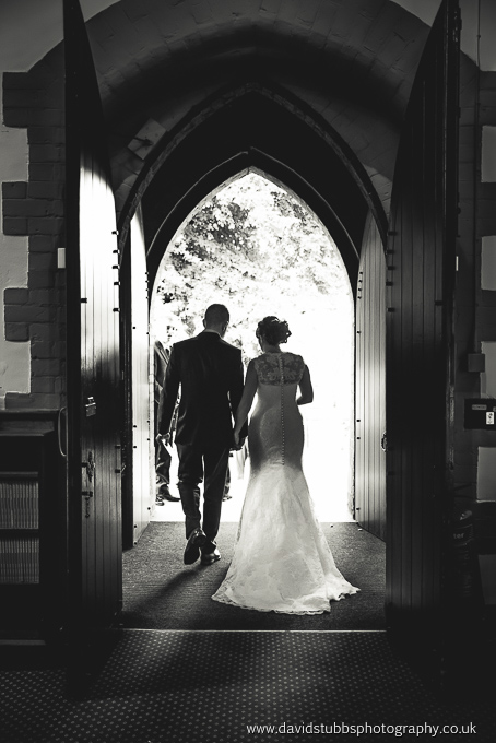 husband and wife exiting church