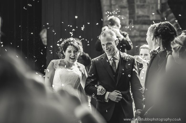 man and wife walking through confetti