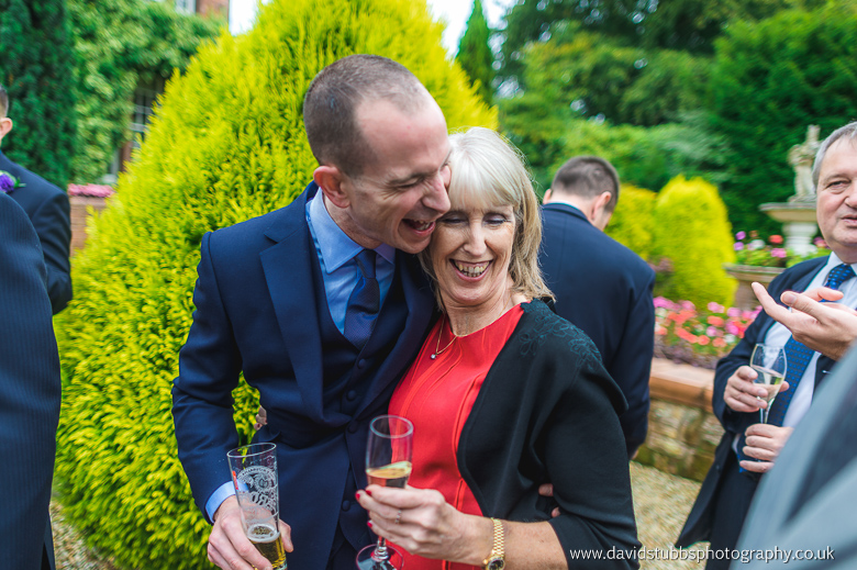 guests laughing in the gardens