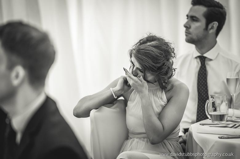 woman watching best man speech