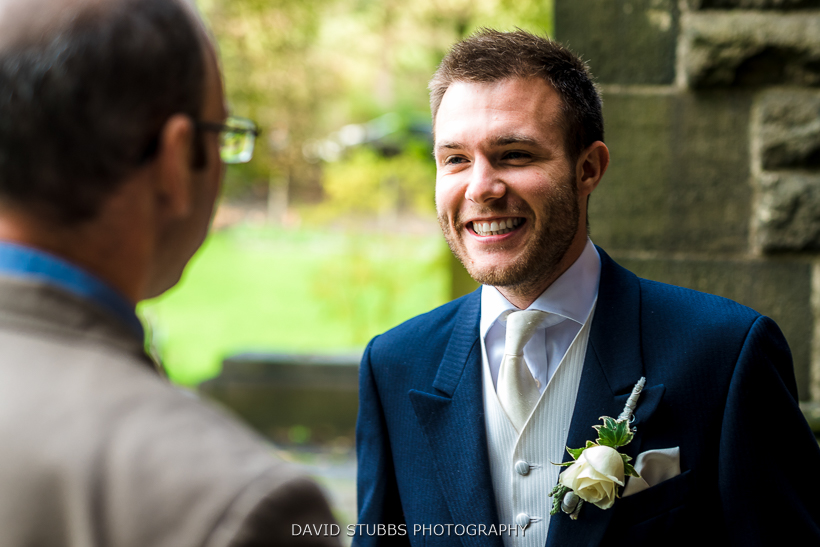 groom greeting guests outside