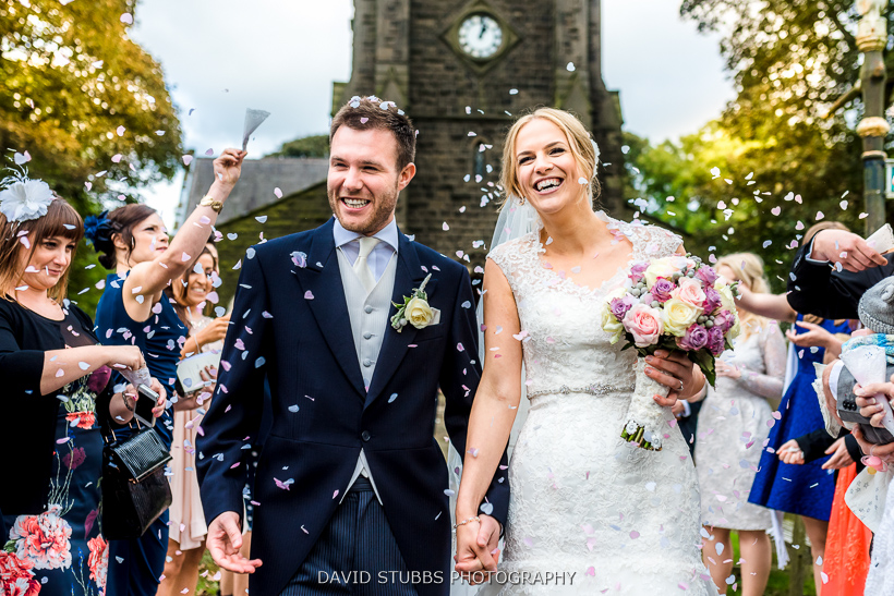 confetti thrown on newly married couple
