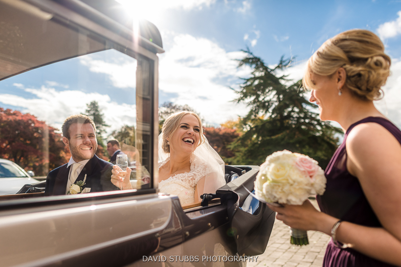 colour photo of man and wife arriving ribble valley wedding