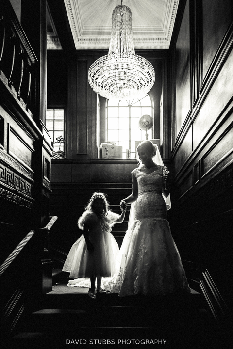 bride and little girl on the stairs