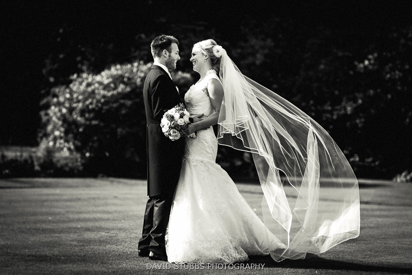 black and white photo of newly married couple  in eaves hall grounds ribble valley wedding photographer