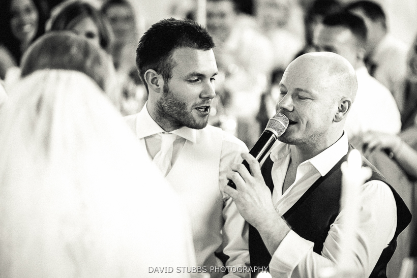 black and white photo of groom singing
