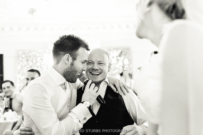 groom and singer on microphone
