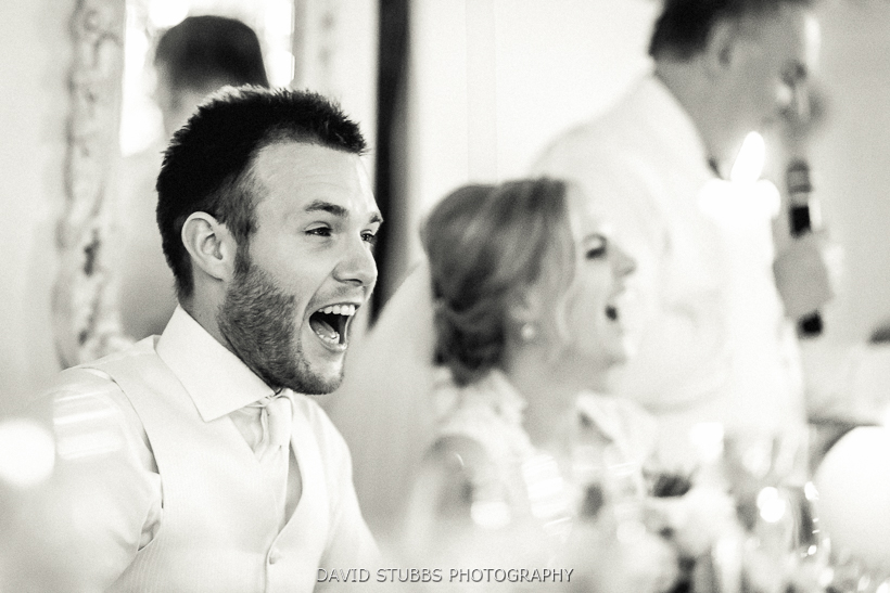 groom reacting to father of the bride speech