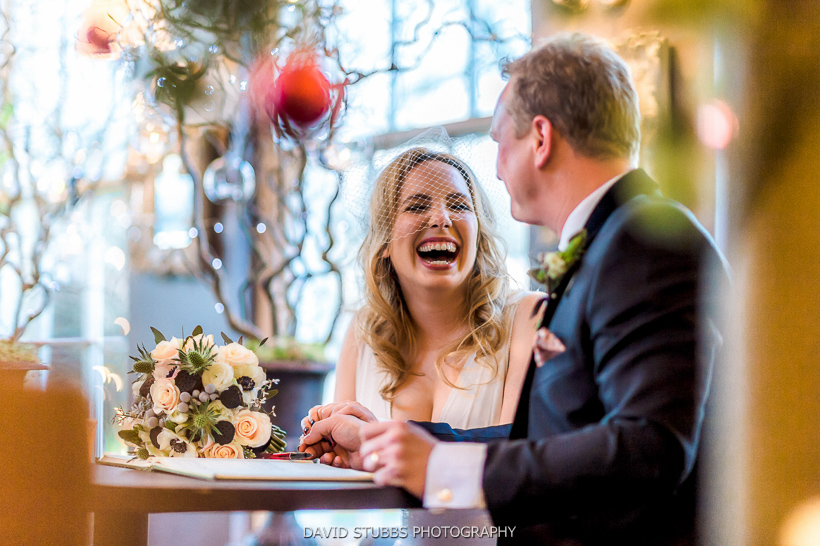 bride and groom laughter after ceremony