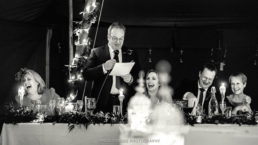 bride laughing at father speech