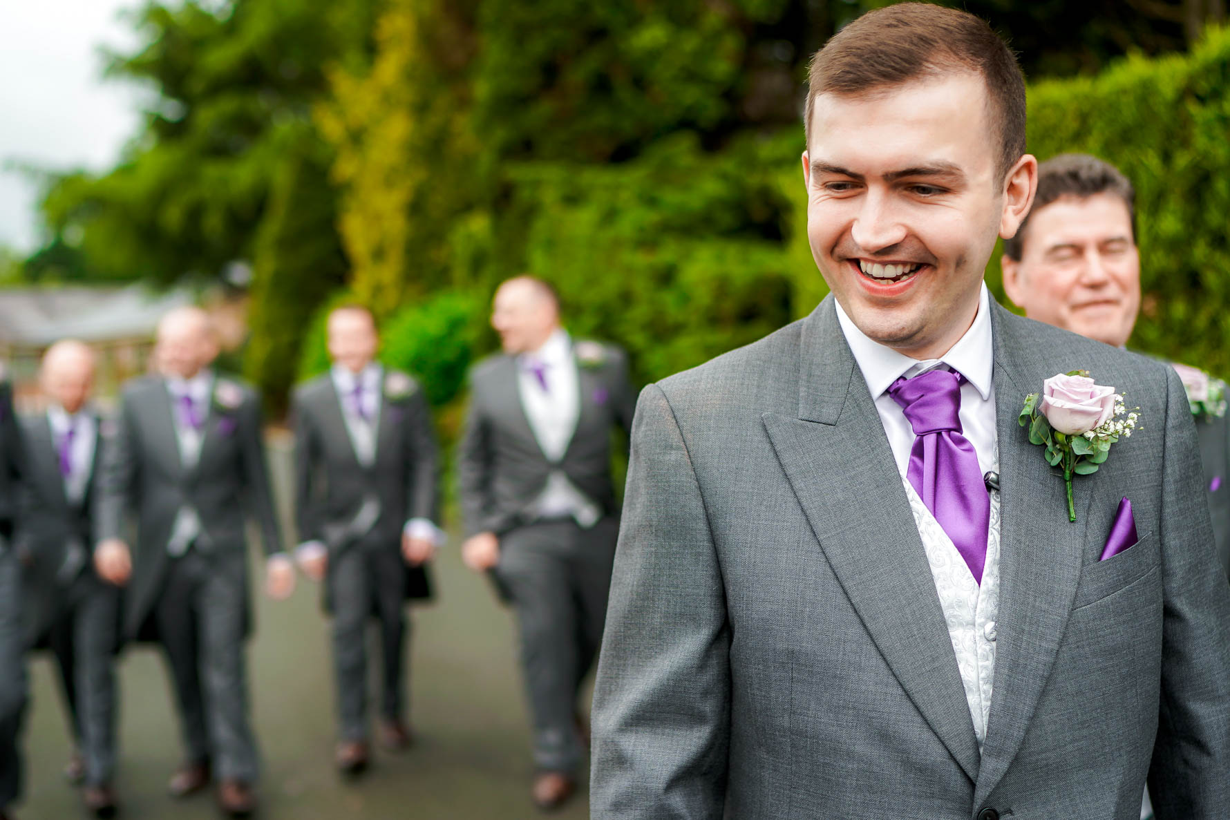 groom walking to the ceremony room at colshaw