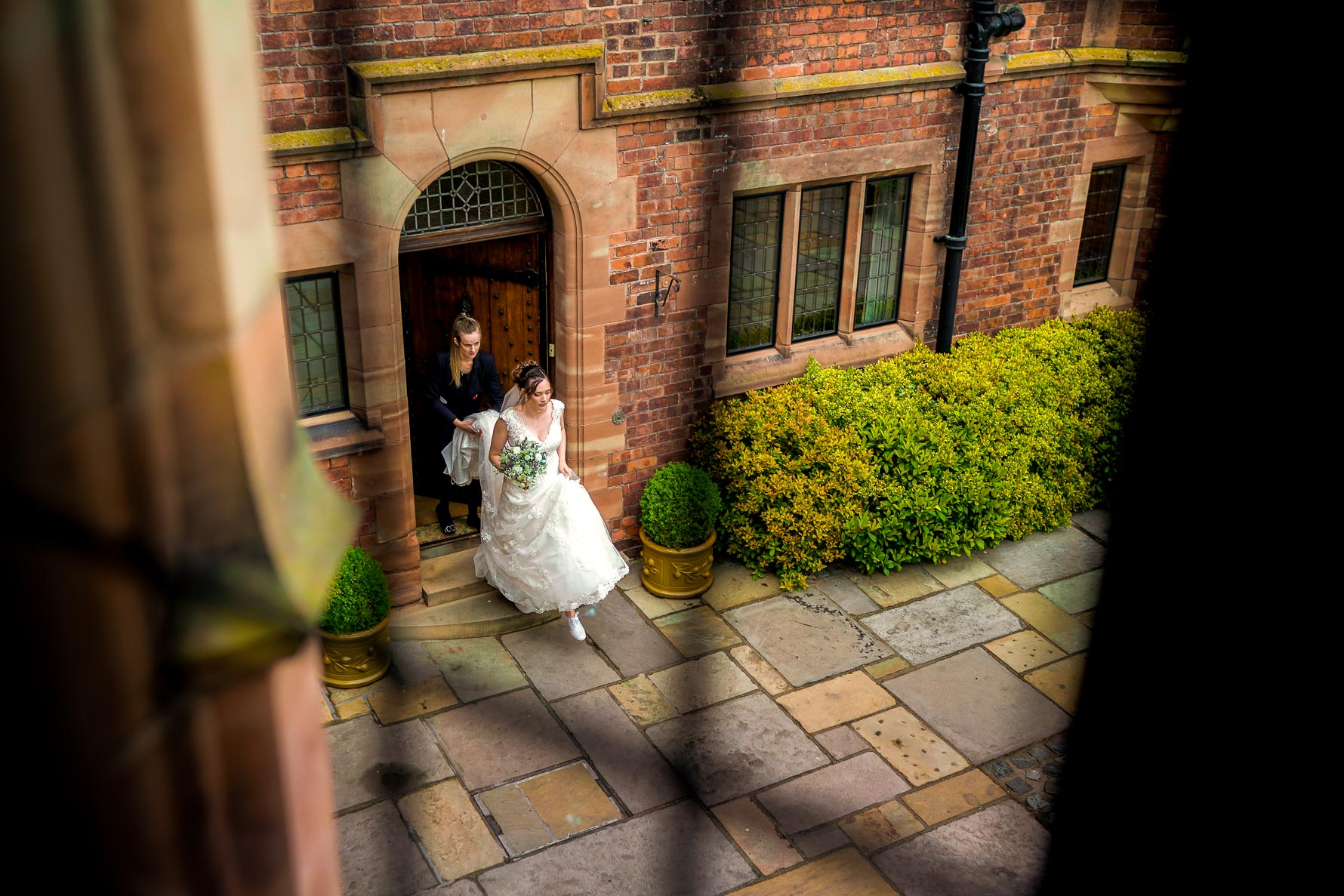 bride leaving colshaw hall from above
