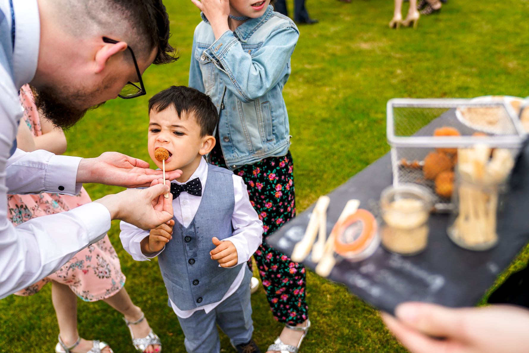 kid eating the canapes