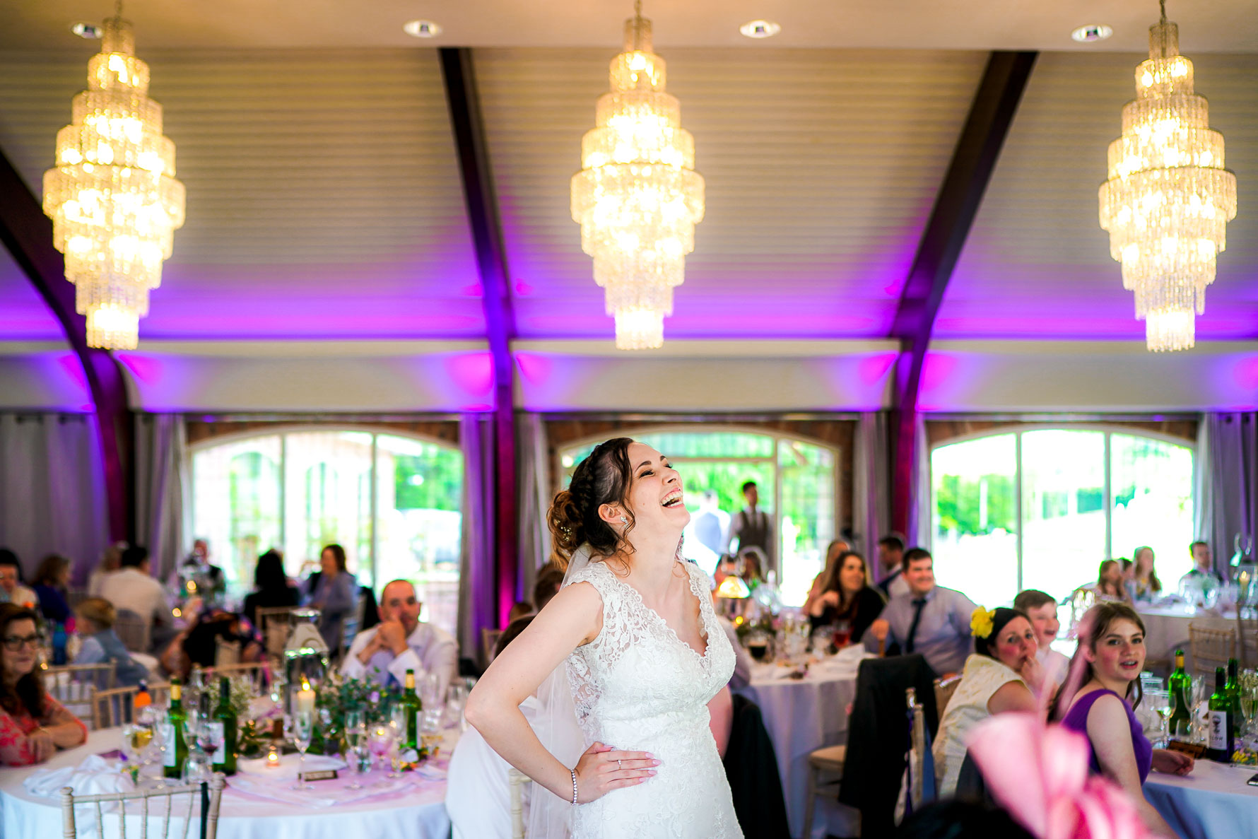 bride laughing in the main hall