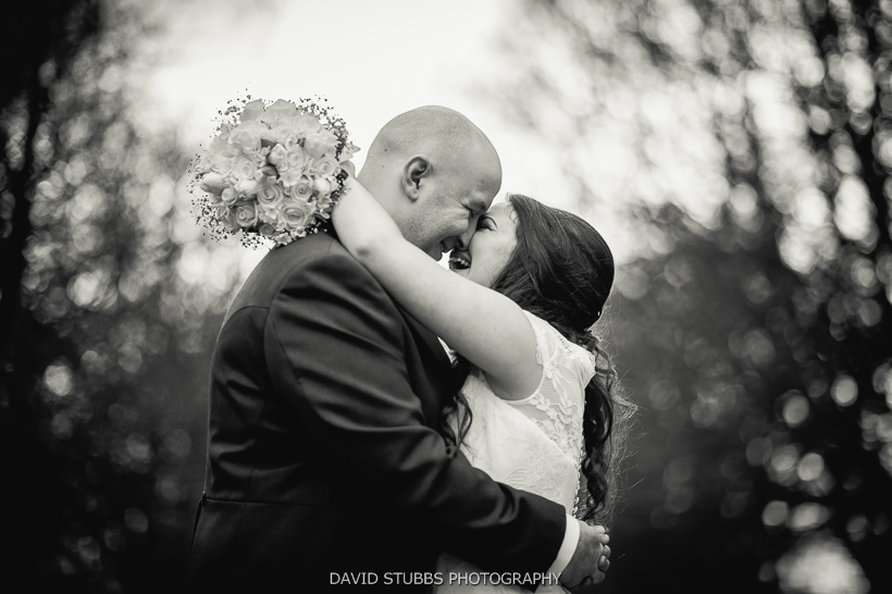 bride and groom kiss black and white