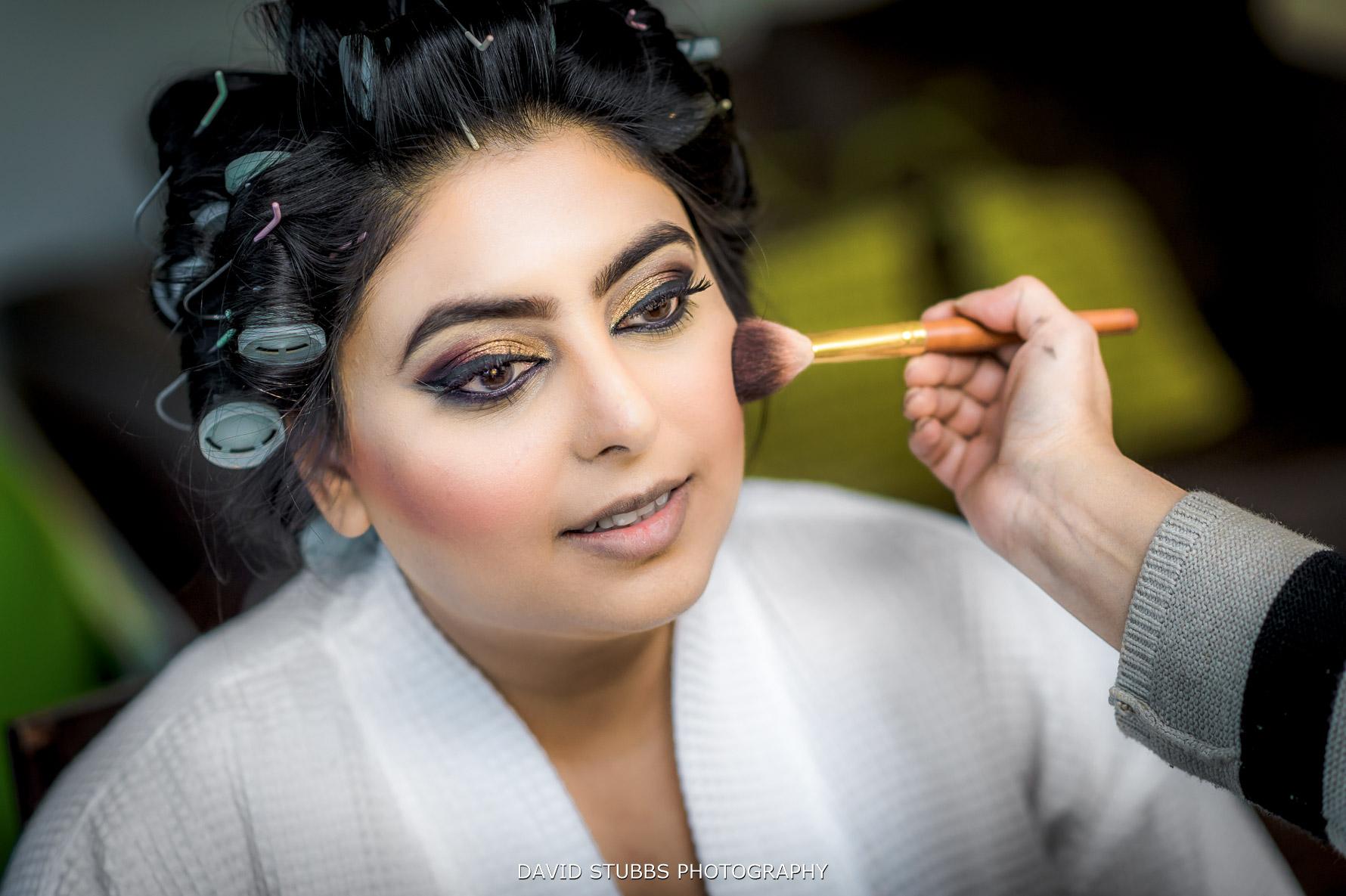 bride having her make-up put on