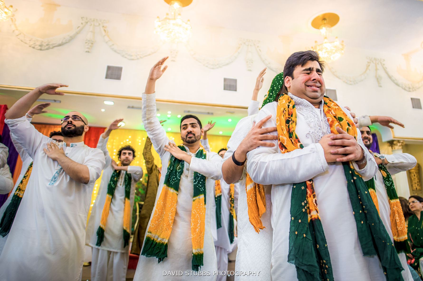 groomsmen dancing and having a great ceremony