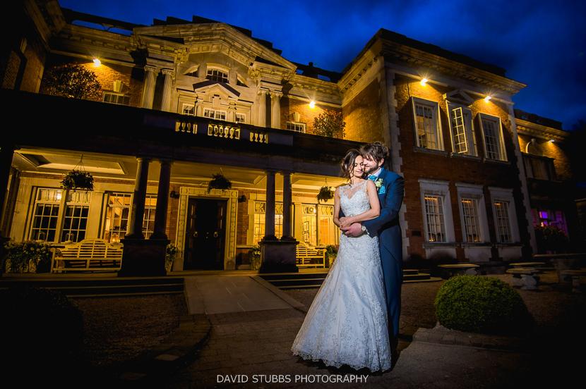 married couple outside eaves hall