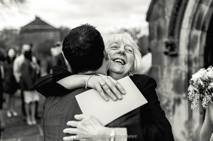 groom and woman laughing