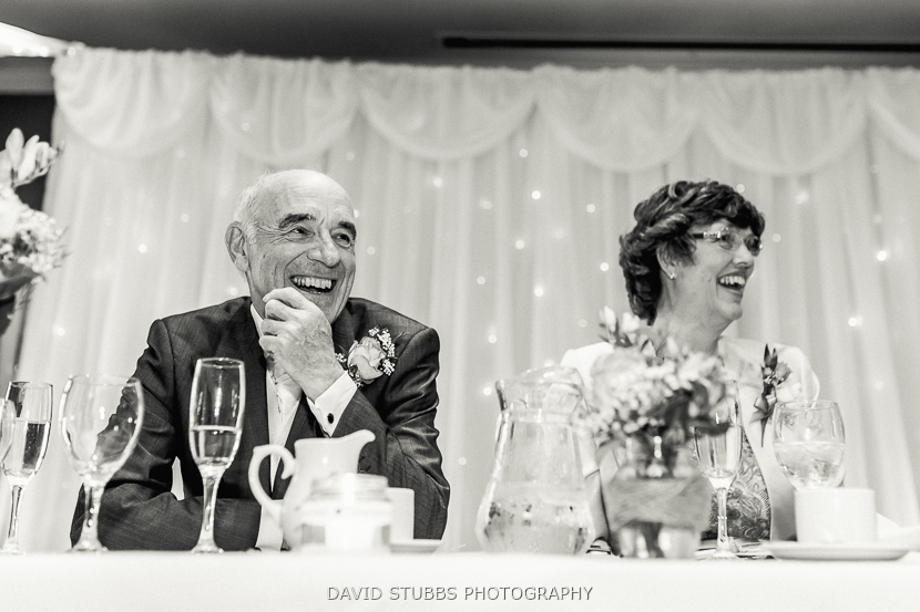 parents laughing black and white