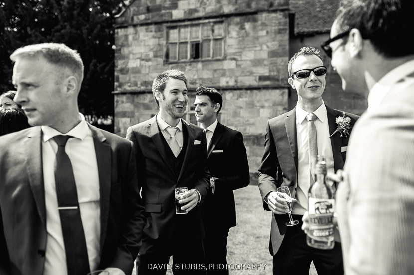 men laughing black and white