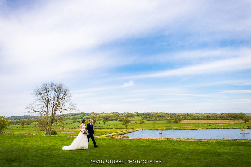 wife and groom by lake
